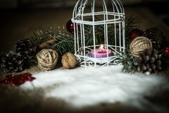 Christmas card.vintage Christmas candle on festive background . Royalty Free Stock Photography