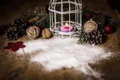 Christmas card.vintage Christmas candle on festive background . Photo with copy space Stock Photos