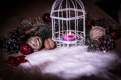 Christmas card.vintage Christmas candle on festive background . Photo with copy space Stock Photo