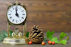 Christmas card with vintage clock and natural Christmas decoration Stock Photography