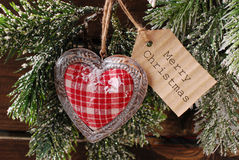 Christmas card with vintage heart and papar tag Stock Photo