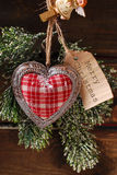 Christmas card with vintage heart and papar tag Stock Image