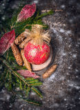 Christmas card with vintage red ball and golden bow on dark wooden Stock Image