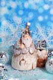 Christmas card with vintage santa figurine on winter blue backgr Stock Photo