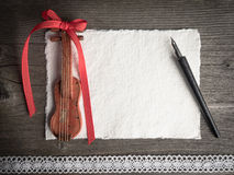 Christmas card, violin, lace and quill on wood Stock Photography