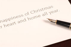Christmas card waiting to be signed by a fountain pen Stock Photo