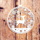 Christmas Card with White Christmas Ornaments on rustic wooden b Stock Photography