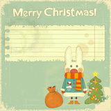 Christmas card with white hare Stock Photo