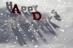 Christmas Card With White And Red Letters, Happy Holidays, Snow Royalty Free Stock Images
