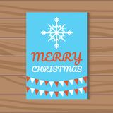 Merry Christmas vector greetings card with a snowflake on a blue background. Christmas card with a white snowflake on a blue background. The inscription of Merry Royalty Free Stock Photos