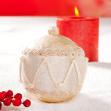 Christmas card of white velvet bauble and candle Stock Photography
