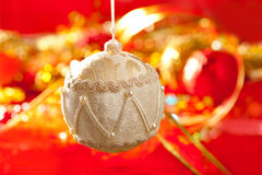 Christmas card of white velvet bauble on red Royalty Free Stock Photography
