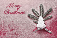 Christmas Card with White Wooden Christmas Tree on Red Snowy Background. Christmas Decoration. Royalty Free Stock Images