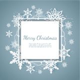 Christmas Card With Paper Snow Flake. Falling Snowflakes On A Dark Blue Winter Background. Royalty Free Stock Image