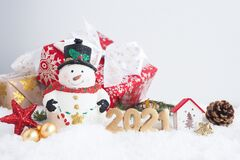 Free Christmas Card With Snowman, Gift Box And Number 2021 On The Snow. Stock Images - 204450884