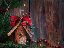 Christmas card with wooden house Stock Images