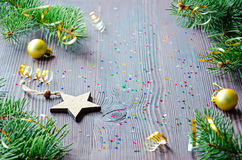 Christmas card with wooden star and Christmas decor Stock Images