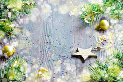 Christmas card with wooden star and Christmas decor Royalty Free Stock Photos