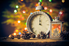 Christmas card wooden table clock cone lantern stock photography