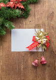 Christmas card on wooden top with christmas ornaments Stock Photo