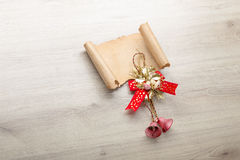 Christmas card on wooden top with christmas ornaments Royalty Free Stock Image