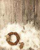 Christmas card with wreath and little hare from birch bark on a wooden background. Royalty Free Stock Images