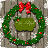 Christmas card with wreath. Royalty Free Stock Image