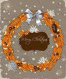 Christmas card with wreath. Royalty Free Stock Photo