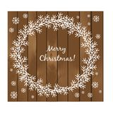 Christmas card with wreath on the wooden background Stock Photo