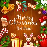 Christmas card with Xmas gift on wooden background Royalty Free Stock Image