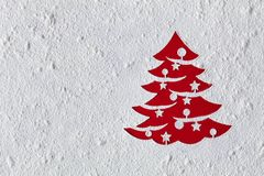 Christmas card with xmas tree drawing in flour, copy space. Christmas card with xmas tree drawing in flour on red table - copy space on nice textured white stock photo