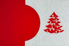 Christmas card with xmas tree drawing in flour on red background royalty free stock photography