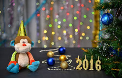 Christmas card 2016. Year of the Monkey. Toy monkey Stock Images