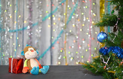 Christmas card . Year of the Monkey. Toy monkey Royalty Free Stock Images