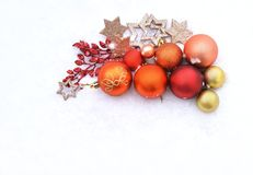 Christmas cards with balls. Christmas balls and glitter stars on white background and snow Royalty Free Stock Image
