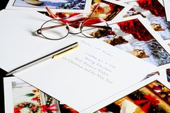 Christmas cards with pen and glasses. Stock Images