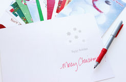 Christmas cards. Personalizing Christmas cards closeup stock photo