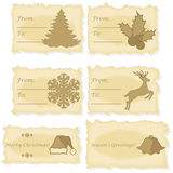Christmas cards printed on old paper. Set of six different Christmas and gift cards printed on old parchment paper Stock Photography