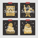 Christmas cards set. Hand drawn Christmas cards set with textured fireplace, Santa Claus, knitted hat, and sack with gifts vector illustrations Royalty Free Stock Image