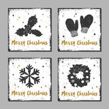 Christmas cards set. Hand drawn Christmas cards set with textured mistletoe, mittens, snowflake, and Christmas wreath vector illustrations Royalty Free Stock Photo