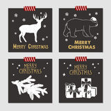 Christmas cards set. Hand drawn Christmas cards set with textured reindeer, polar bear, fir tree branch, and pile of gift boxes vector illustrations Royalty Free Stock Photo