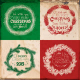 Christmas cards. Set of 4 Christmas cards with hand -drawn wreaths made of fir branches decorated with baubles, bows and star on grunge background with old paper Royalty Free Stock Photos