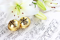 Christmas carol. Christmas still life with jingle bells and music notes Royalty Free Stock Photos