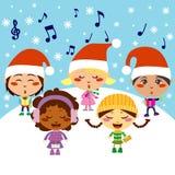 Christmas Carol. Five kids singing Christmas Carols while snow falls Stock Photo