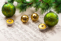 Christmas carol. With jingle bells and candles Royalty Free Stock Image