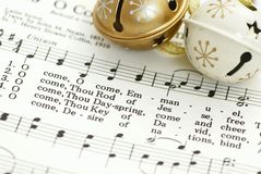 Christmas carol. Detail of songbook with Christmas carols and christmas decoration Royalty Free Stock Image