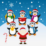 Christmas Carol with Penguins Orchestra. A funny cartoon Christmas orchestra with five cute penguin characters playing musical instruments and singing carols and Stock Image