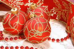 Christmas carol sheet notes. With red decorations and ribbon Stock Images