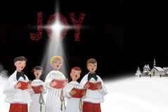 Christmas Carolers. In snow with starlight Royalty Free Stock Photos