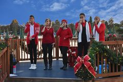 Christmas carolers performing on lightblue cloudy background in International Drive area. Orlando, Florida. November 18 2018. Christmas carolers performing on royalty free stock photo
